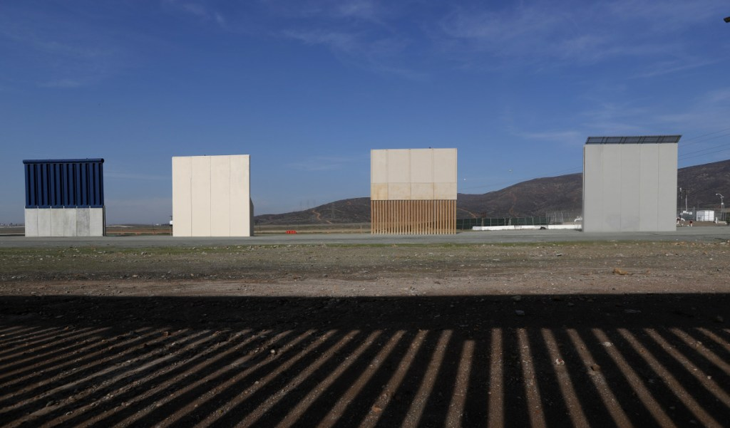 Border wall prototypes stand in San Diego last month near the Mexico-U.S. border. The photo was taken in Tijuana, Mexico, where the current wall casts a shadow in the foreground.