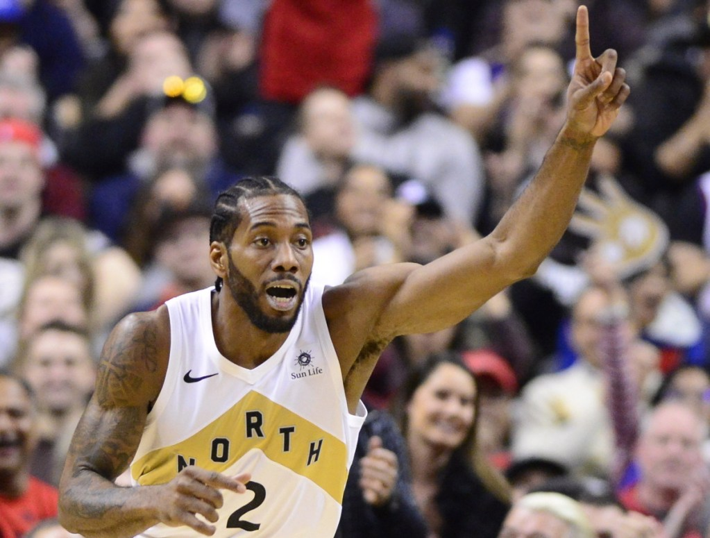 Kawhi Leonard of the Toronto Raptors celebrates after scoring in the first half Friday night. Leonard finished with 20 points in a 122-105 victory at home against the Brooklyn Nets.