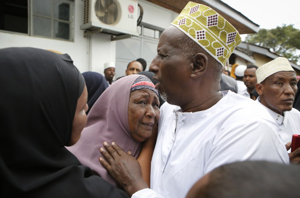 Mourners grieve as they prepare to pray over the bodies of Abdalla Dahir and Feisal Ahmed, who were killed in Tuesday's attack, at a mosque in Nairobi, Kenya, on Wednesday. The two worked for the Somalia Stability Fund, managed by the London-based company Adam Smith International, and were killed in Tuesday's assault by Islamic extremist gunmen on a luxury hotel and shopping complex.
