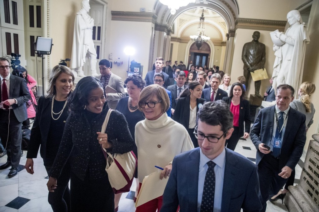 Freshmen members of the House, lead by Rep. Susie Lee, D-Nev., center, deliver a letter calling for an end to the government shutdown to the office of Senate Majority Leader Mitch McConnell of Kentucky on Capitol Hill in Washington on Wednesday. Also pictured are Rep. Katie Hill, D-Calif, left, Rep. Jahana Hayes, D-Conn., second from left, Rep. Alexandria Ocasio-Cortez, D-N.Y., center right, Rep. Angie Craig, D-Minn., second from right, and others.