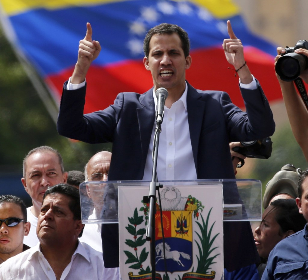 Juan Guaido, head of Venezuela's opposition-run congress, declares himself interim president of the nation until elections can be held Wednesday.