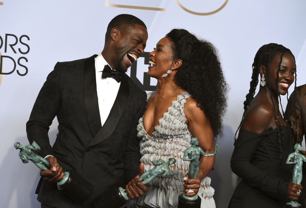 "Sterling K. Brown, left, winner of the awards for outstanding performance by a cast in a motion picture for ""Black Panther"" and the award for outstanding performance by an ensemble in a drama series for ""This Is Us,"" laughs with Angela Bassett, winner of the award for outstanding performance by a cast in a motion picture for ""Black Panther,"" at the 25th annual Screen Actors Guild Awards at the Shrine Auditorium & Expo Hall on Sunday in Los Angeles."