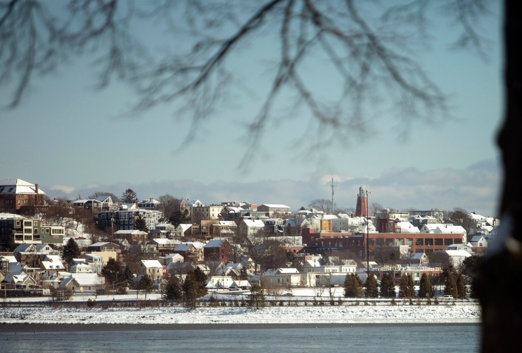 The snow-covered rooftops on the East End of Portland as seen from Back Cove after the overnight snowfall on Wednesday