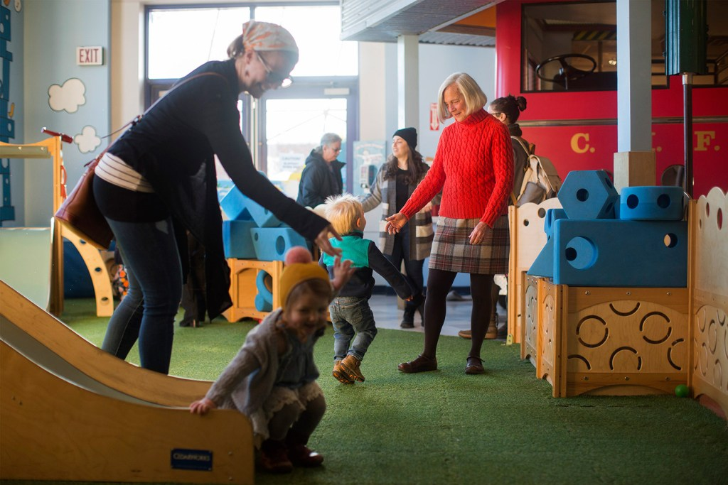 Suzanne Olson, right, works at the Children's Museum of Maine on Monday. Olson, the longtime director of the museum, will retire at the end of June.