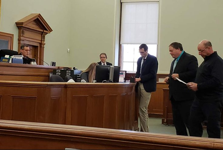 Brandon Luzzi, far right, in Knox County Superior Court on Wednesday. From left, Justice Bruce Mallonee, court security supervisor Jenn Daniels, Deputy District Attorney Jeffrey Baroody, defense attorney Michael Harman, and Luzzi.