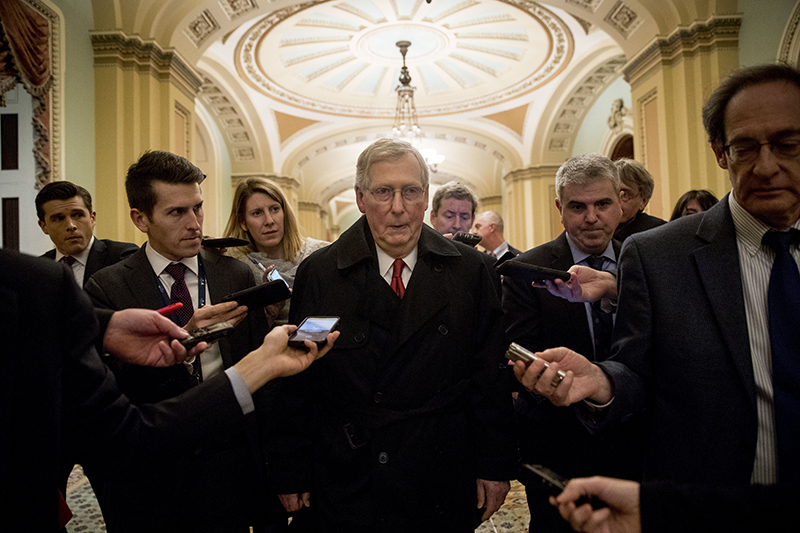 Senate Majority Leader Mitch McConnell leaves for the day after two Senate bills to ending the partial government shutdown fail on Capitol Hill in Washington on Thursday.