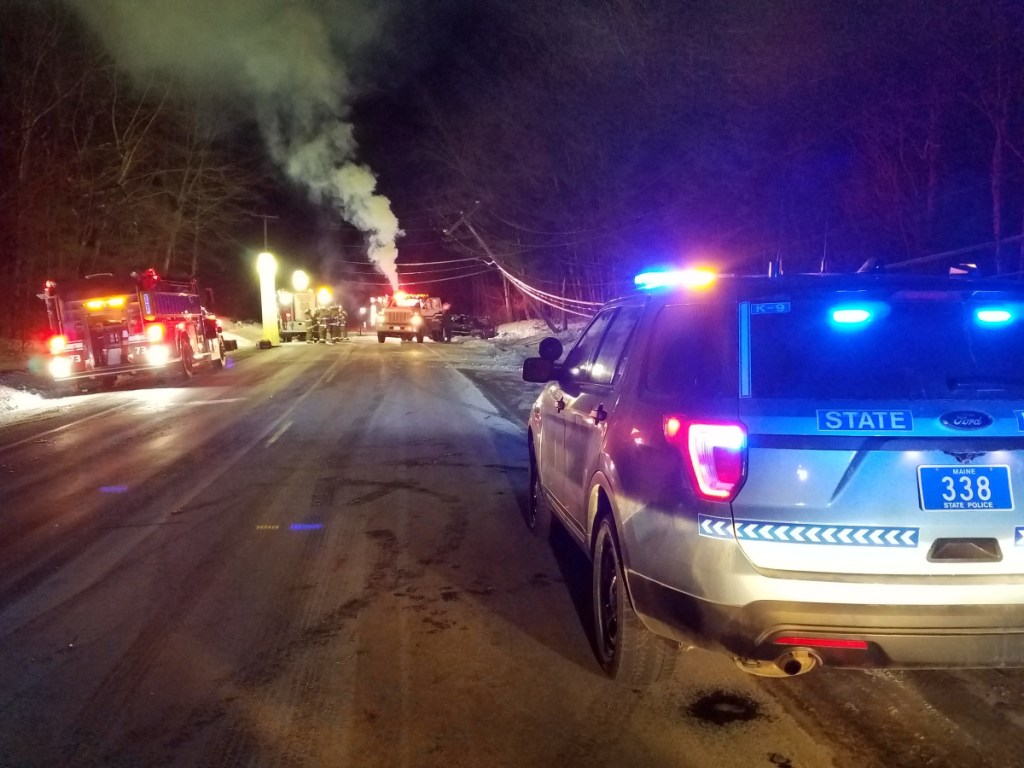 Authorities attend to a fatal crash Friday off Route 133 in Wayne. Police said Michael Fitzherbert, 35, of Hartford, was killed when his SUV veered off the road and crashed into a utility pole.