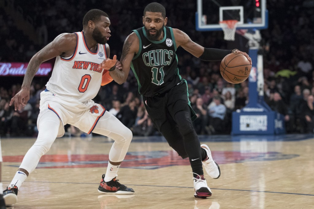 Celtics guard Kyrie Irving, who was cheered by the crowd in New York, drives to the basket against Knicks guard Kadeem Allen during Boston's 113-99 win Friday.