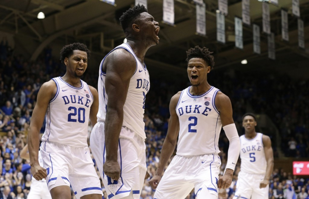 Duke's Zion Williamson, center, celebrates with Marques Bolden, left, and Cam Reddish during a 91-61 win Saturday against St. John's.