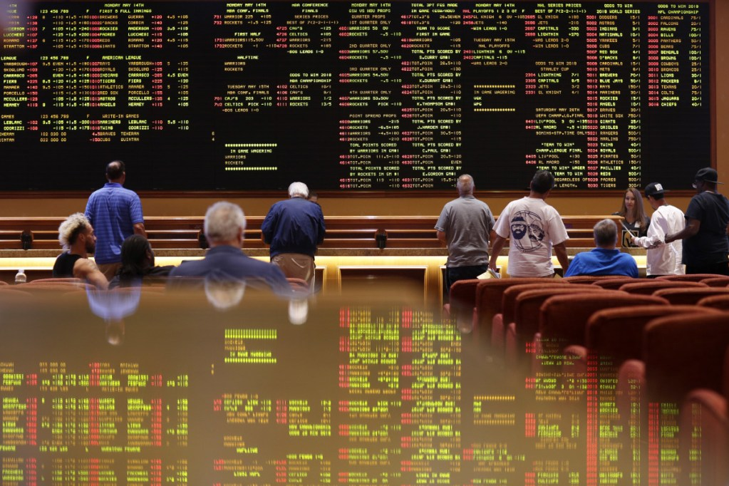 People make bets in the sports book at the South Point hotel and casino in Las Vegas in 2018. Las Vegas is not worried about the competition from casinos in other states that for the first time Sunday will also offer football fans a chance to bet on the Super Bowl.