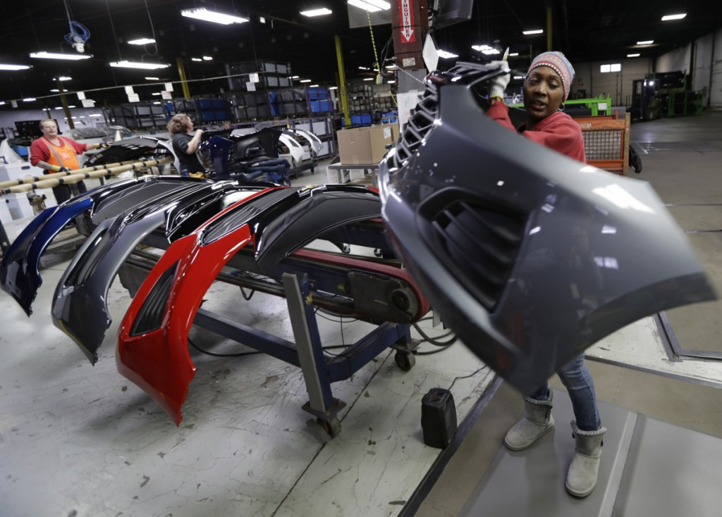 Mari Keels transfers a front end of a Chevrolet Cruze at Jamestown Industries, in Youngstown, Ohio, on Nov. 28, 2018. Jamestown Industries, which supplies front and rear bumper covers for the Cruze, hopes its efforts to secure new business will allow its Youngstown plant to keep going. But the plant is down from three shifts to one and GM is still its biggest customer.