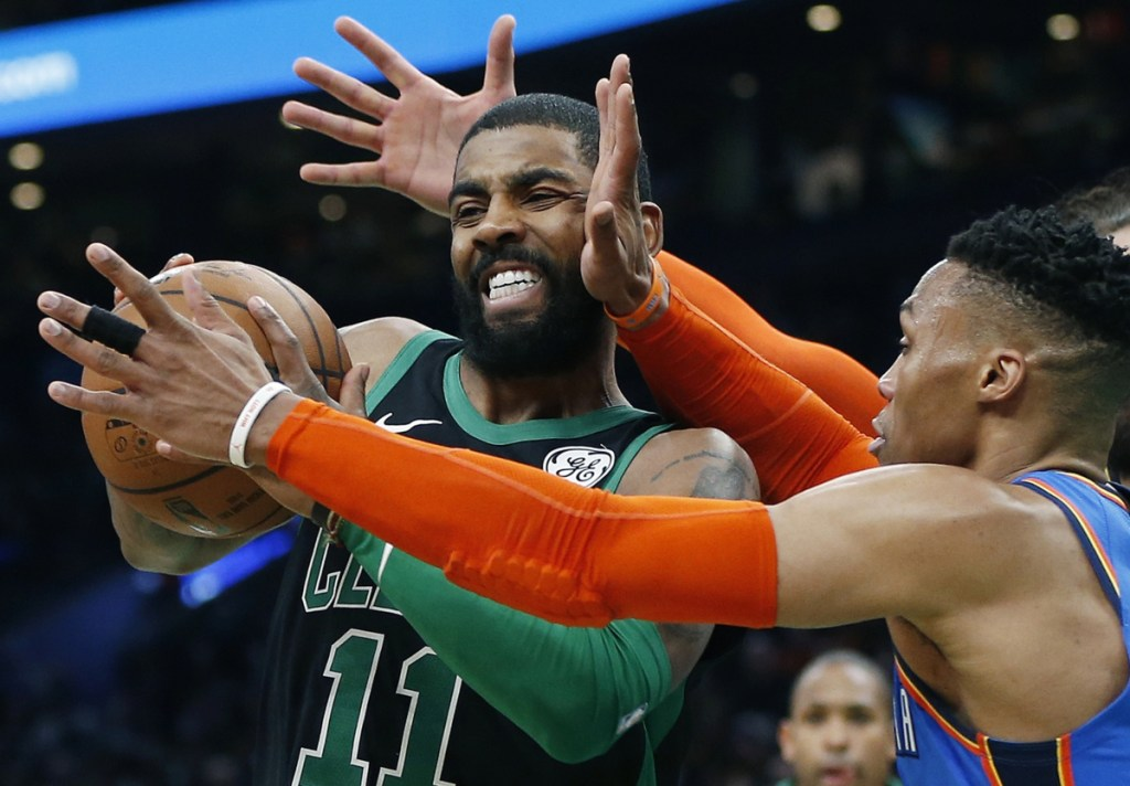 Oklahoma City's Russell Westbrook, right, defends against Boston's Kyrie Irving, left, during the first half of the Celtics' 134-129 win Sunday in Boston.