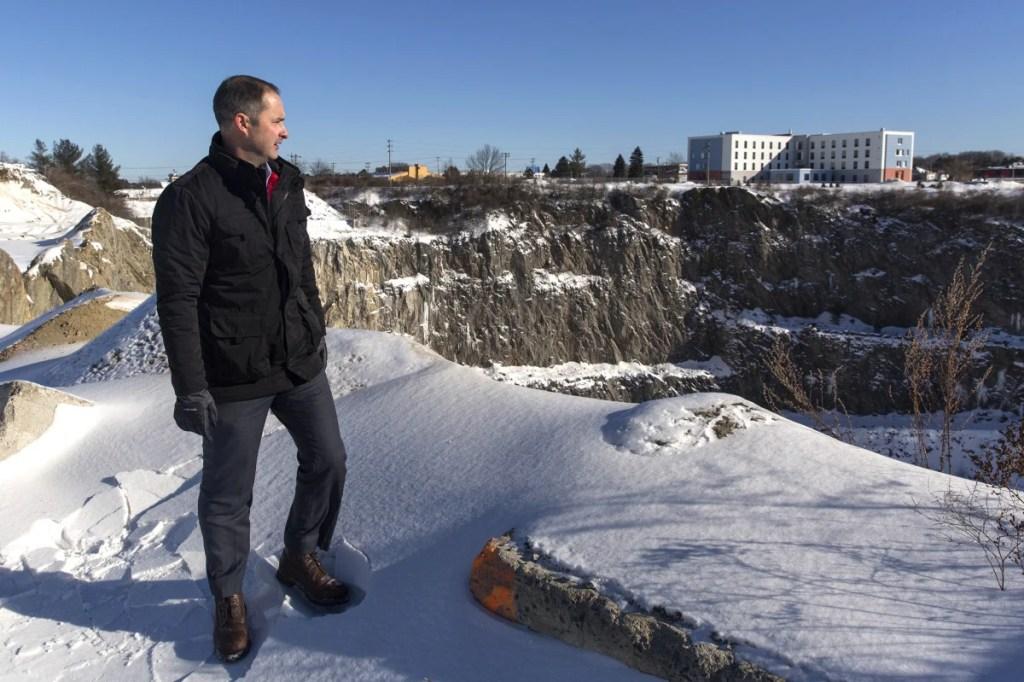 Developer Josh Levy near the quarry at the Rock Row site. The quarry will be made into a lake, which will be the focal point of the mixed-use development.