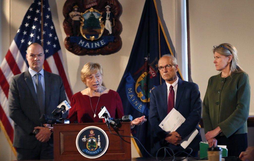 Gov. Janet Mills speaks at a news conference at the State House on Wednesday, accompanied by Corrections Commissioner Randy Liberty, left, Director of Opioid Response Gordon Smith, second from right, and Health and Human Services Commissioner Jeanne Lambrew. Mills later signed an executive order directing immediate action on Maine's opioid epidemic.