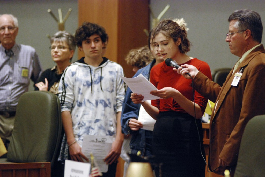 High school student Sophia Lussiez, 17, of Santa Fe, N.M., second from right, testifies in support of proposals for new gun safety regulations in New Mexico, in Santa Fe, N.M., earlier this month.