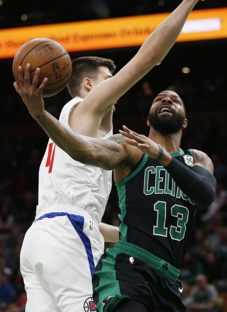 Boston's Marcus Morris, right, takes a shot during Saturday's fall-from-ahead loss to the Clippers. Morris sees a lack of comaraderie within the team.