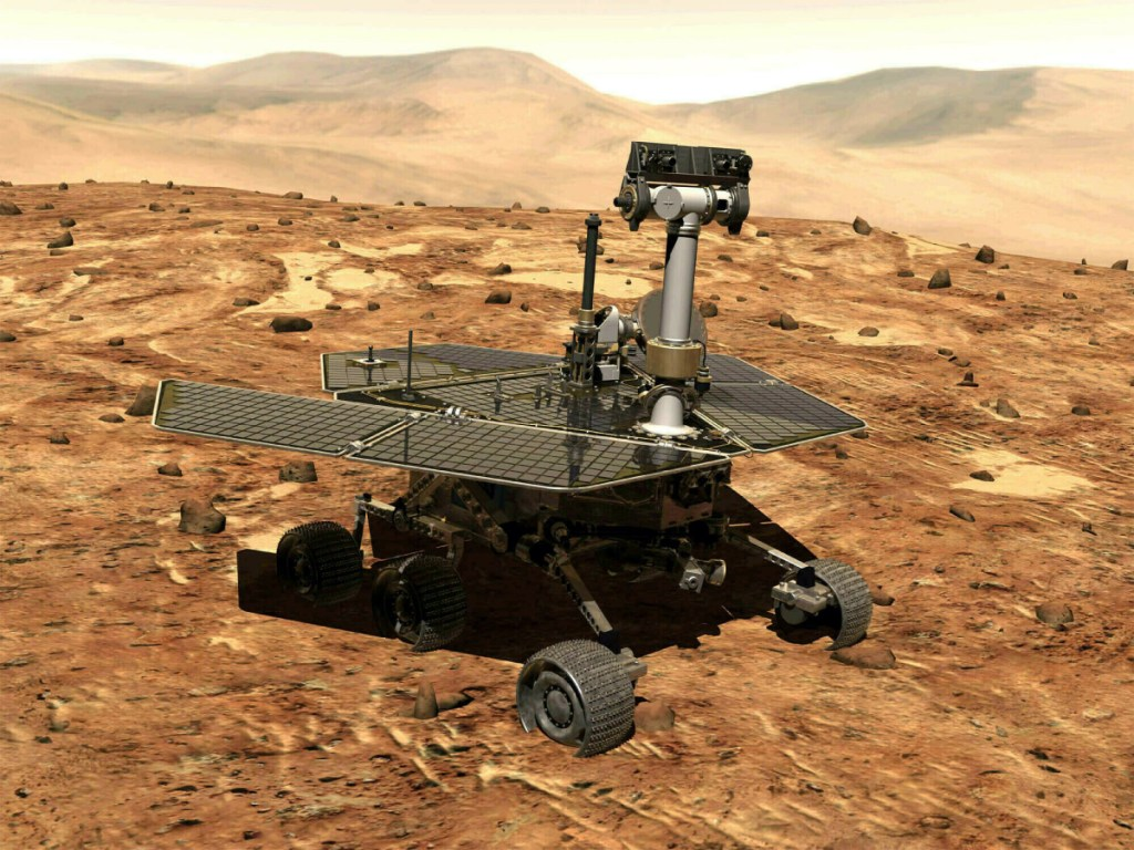 This illustration made available by NASA shows the rover Opportunity on the surface of Mars. The exploratory vehicle landed on Jan. 24, 2004, and logged more than 28 miles before falling silent during a global dust storm in June 2018. There was so much dust in the Martian atmosphere that sunlight could not reach Opportunity's solar panels for power generation.