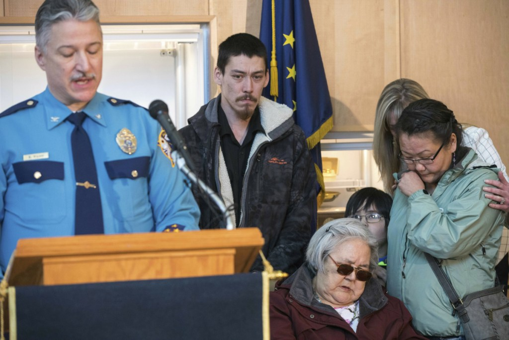 Col. Barry Wilson, director of the Alaska State Troopers, speaks Friday in Anchorage, announcing the arrest in Auburn, Maine, of Steven Downs in the 1993 murder of Sophie Sergie, 20. At right is her brother Stephen Sergie, her mother, Elena Sergie, and Olga Tinker-John, Elena's niece. Comforting Olga is Alaska Department of Public Safety Commissioner Amanda Price.