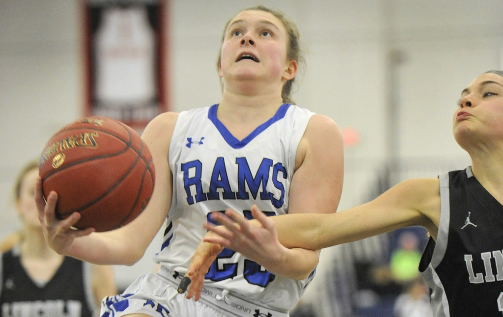 Emily Archibald is fouled on a drive in the lane during Kennebunk's 51-33 victory in a Class A South quarterfinal Monday at the Portland Expo. Archibald scored a team-high 17 points for the Rams.