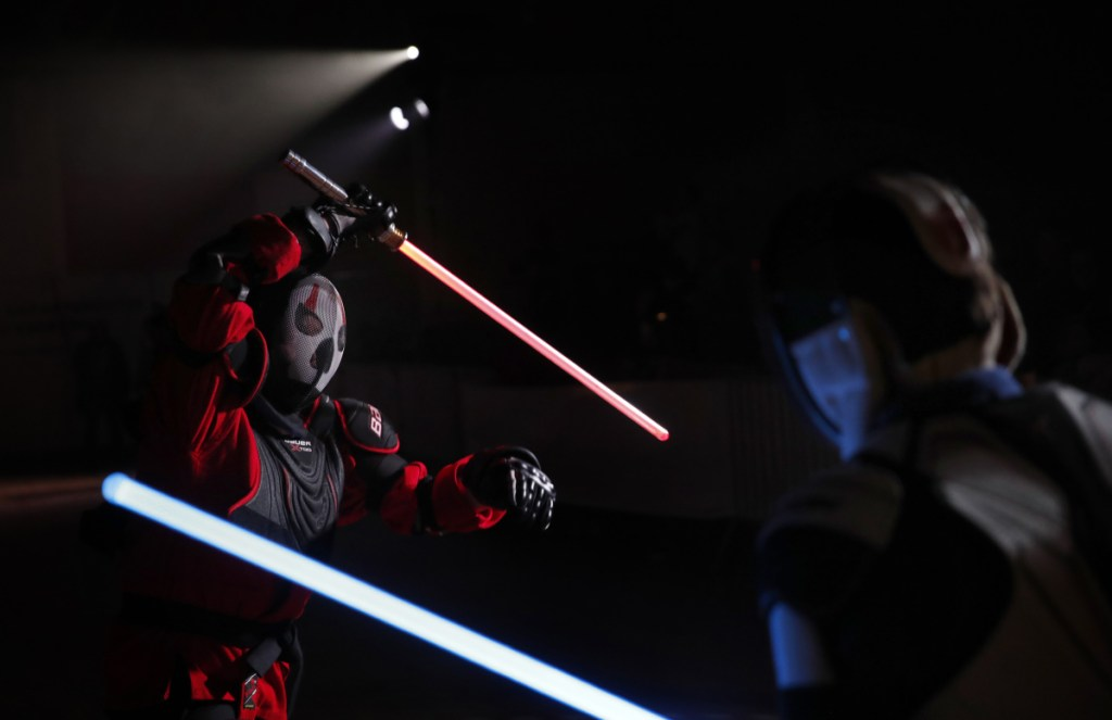 Julien Esprit, left, competes with Jean Baptiste Marchetti-Waternaux during a lightsaber tournament in France. The fencing federation has officially recognized lightsaber dueling as a competitive sport.
