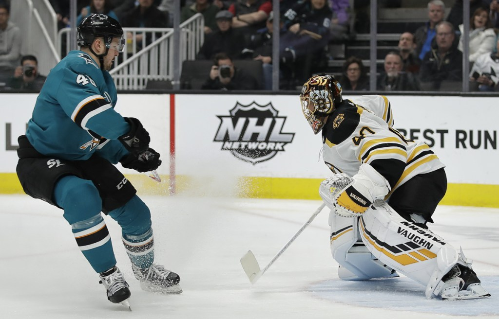 Bruins goalie Tuukka Rask defends against a shot from the Sharks' Tomas Hertl during the first period Monday night in San Jose, Calif.