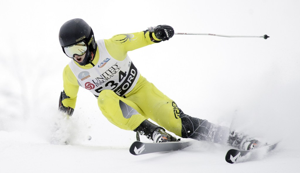 Devon Lathrop of Cape Elizabeth charges down the giant slalom course in his second run Thursday at Black Mountain to capture his third individual state title and lead his team to the Class B Alpine title.