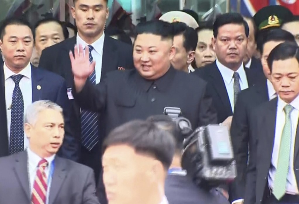 In this image from video, North Korean leader Kim Jong Un waves on his arrival in the border town of Dong Dang, Vietnam, on Tuesday before his second summit with President Trump.