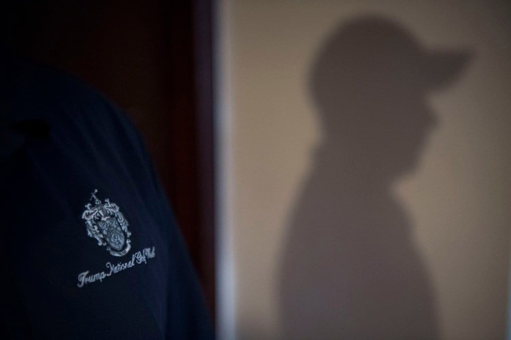 An undocumented immigrant, who did not want to be identified and who was recently fired from his job in the kitchen at the Trump National Golf Club Westchester, is seen in profile in the home of a fellow worker in Ossining, N.Y.