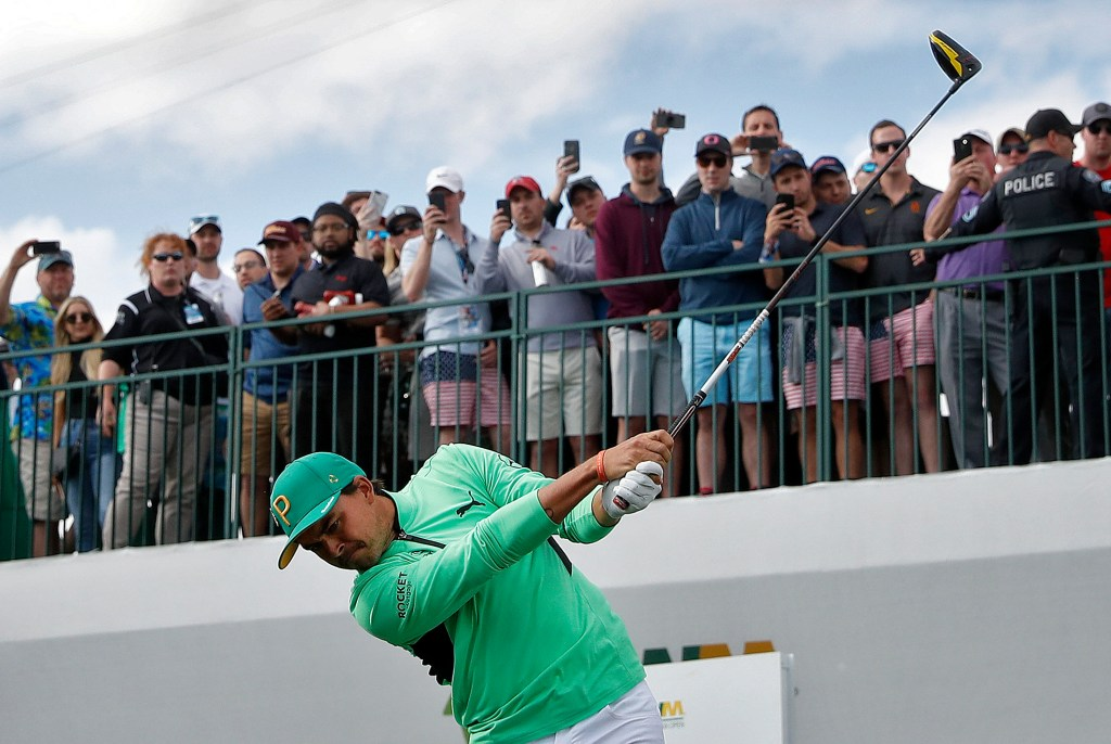 Rickie Fowler hits from the 17th tee during the third round of the Phoenix Open on Saturday in Scottsdale, Ariz.