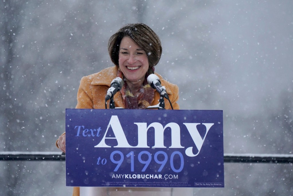 Sen. Amy Klobuchar greets the crowd before announcing her bid for president at Boom Island Park in Minneapolis on Sunday.
