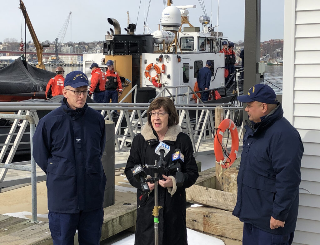 Sen. Susan Collins talks to reporters Wednesday after a ribbon-cutting ceremony for a renovated command center at the U.S. Coast Guard station in South Portland. Collins was joined by Rear Adm. Andrew Tiongson, right, and Sector Northern New England Commander Capt. Brian LeFebvre.
