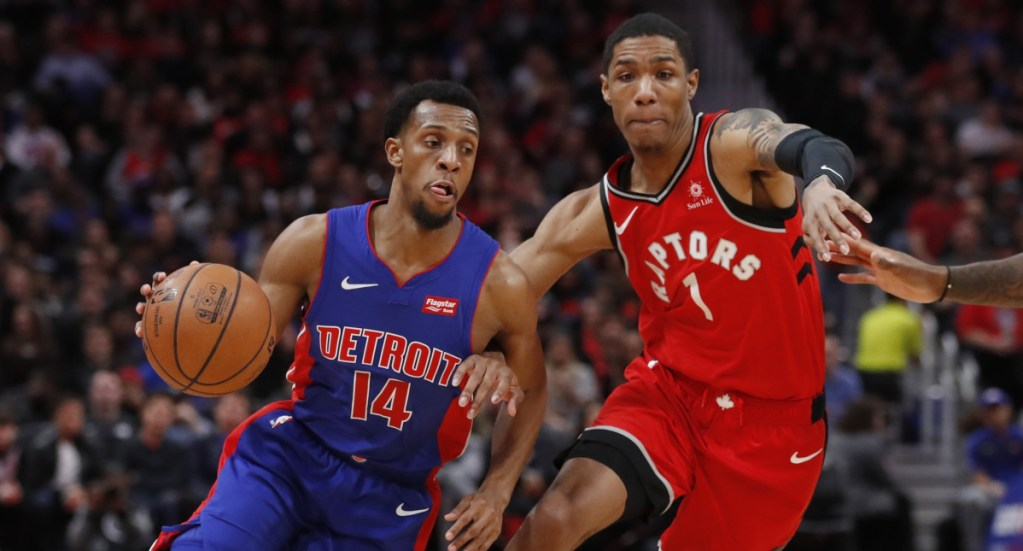 Ish Smith of the Detroit Pistons looks for room to drive Sunday night against Patrick McCaw of the Toronto Raptors during the first half of Detroit's 112-107 overtime victory.