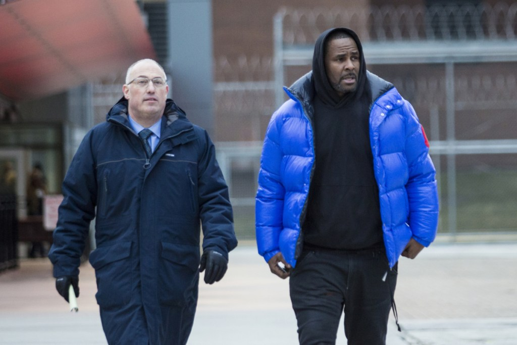 """R. Kelly leaves Cook County Jail in February with his defense attorney, Steve Greenberg, after posting $100,000 bail. He was taken back into custody on Wednesday. In his first interview since being charged with sexually abusing four people, including three underage girls, R. Kelly says he """"didn't do this stuff"""" and he's """"fighting for his life."""