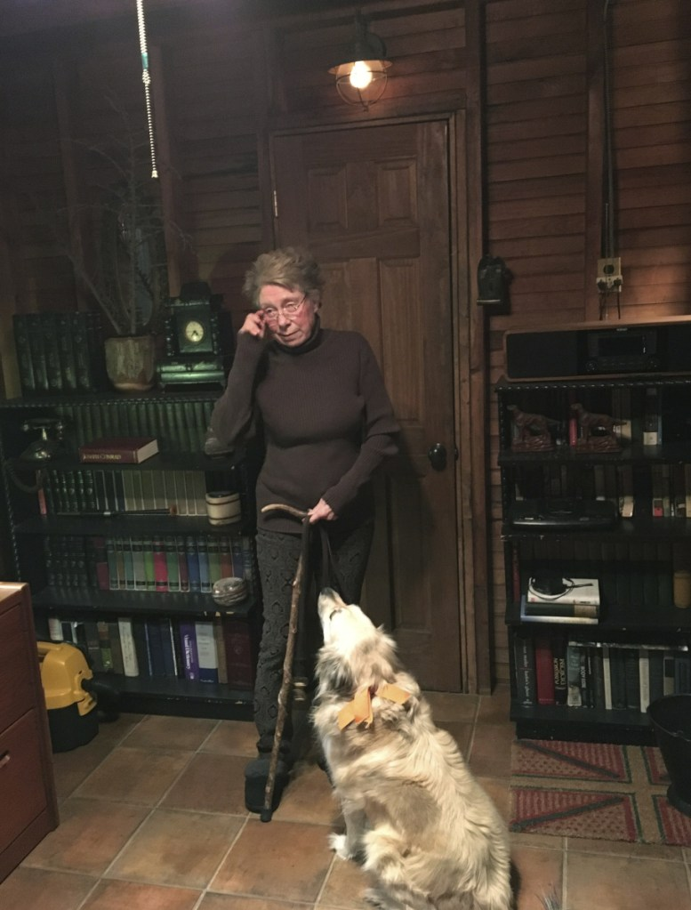 Susan Bush stands with her dog at her Pocono Pines, Pa., cottage. Bush has had several injuries while taking falls while walking her dog. A new study suggests broken bones from falls while dog-walking are on the rise among older adults and hip fractures are among the most common injuries.