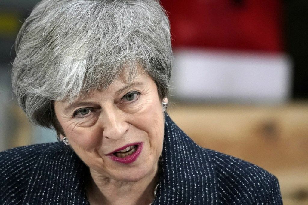 """British Prime Minister Theresa May gives a speech Friday in Grimsby, Britain. Battling to stave off a second defeat for the unpopular Brexit deal, May also implored the EU to help her make """"one more push"""" to get her agreement through a skeptical British Parliament."""