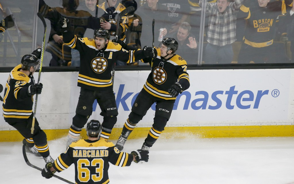 Bruins center Patrice Bergeron scores the first of his two third-period goals at 8:50 to tie the game at 2 on Thursday night against Florida. He scored the winning goal with 6.7 seconds left.