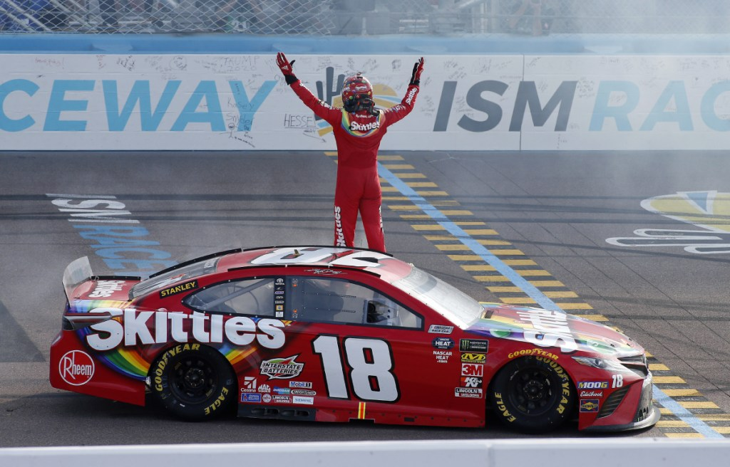 Kyle Busch acknowledges the fans after winning the Cup Series race Sunday in Avondale, Ariz. It's the 52nd career Cup Series win for Busch, and his 199th win overall, including the Xfinity and Truck Series.