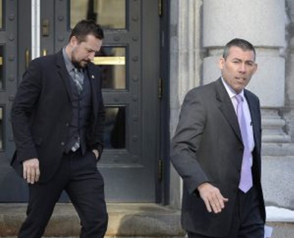 Federal Deportation Officer Elliot Arsenault, left, and Maine State Trooper Robert Burke III leave U.S. District Court in Portland, after motions were heard in an immigration case.