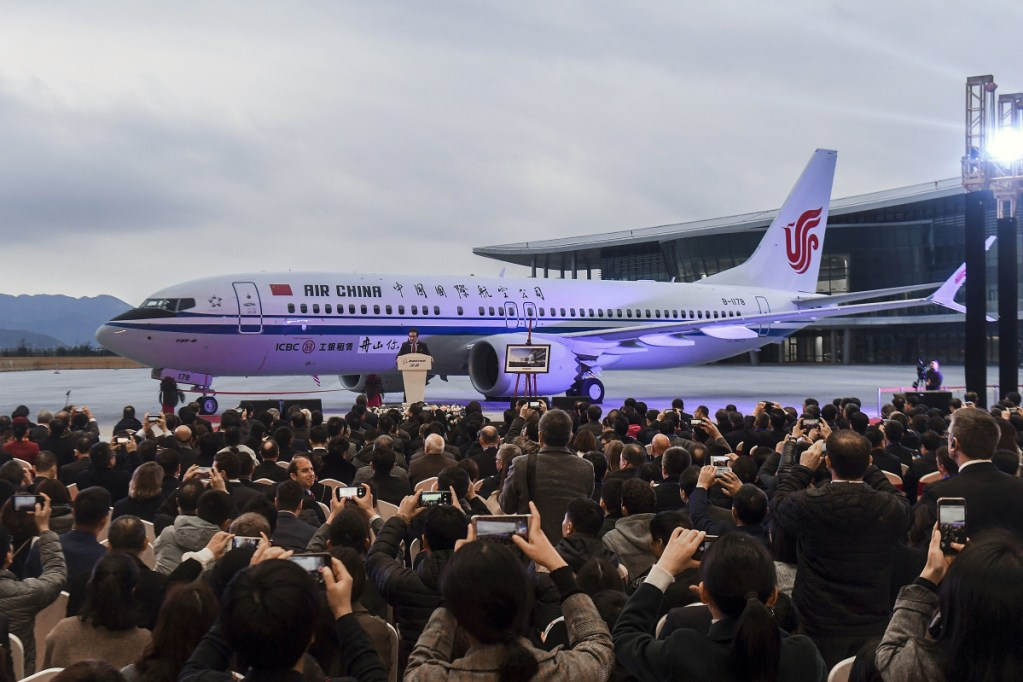 Invited guests take photos of the Boeing 737 Max 8 airplane delivered to Air China during a ceremony in December in Zhoushan. China's civilian aviation authority on Monday ordered all Chinese airlines to ground their Boeing 737 after one of the aircraft crashed in Ethiopia.