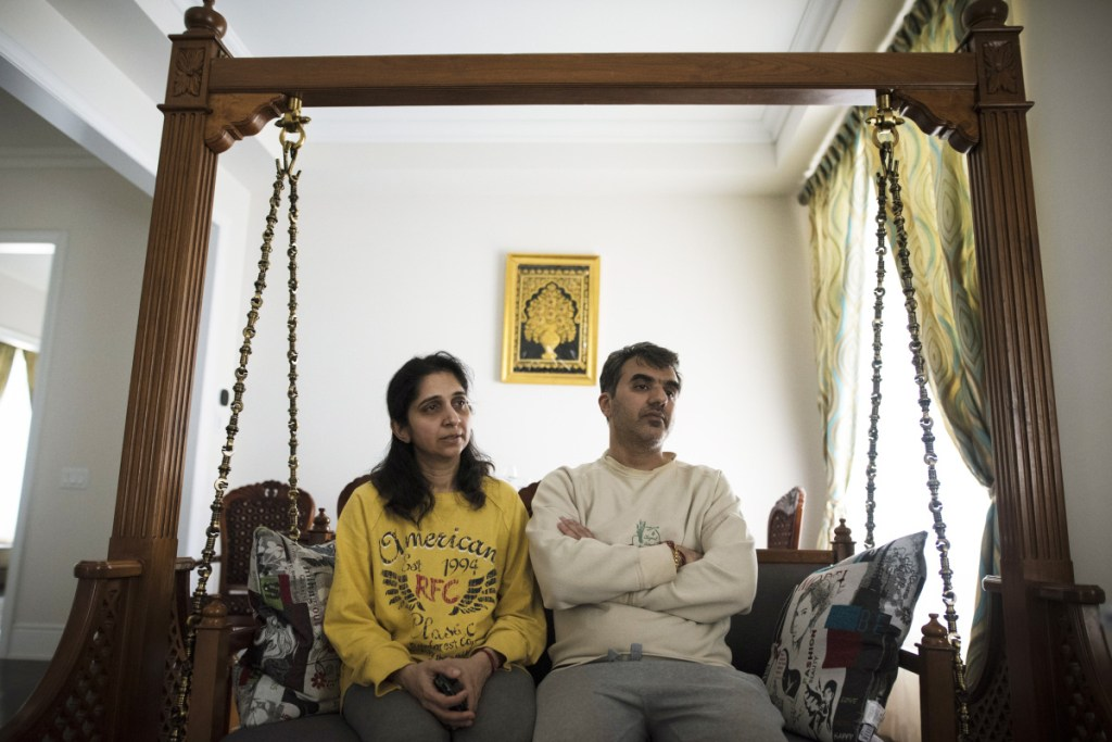 Manant Vaidya is joined by his wife Hiral, left, as he speaks to a reporter Monday Brampton, Ontario, about losing his two parents, sister, brother-in-law, and two young nieces in the crash of an Ethiopian Airlines jetliner Sunday.