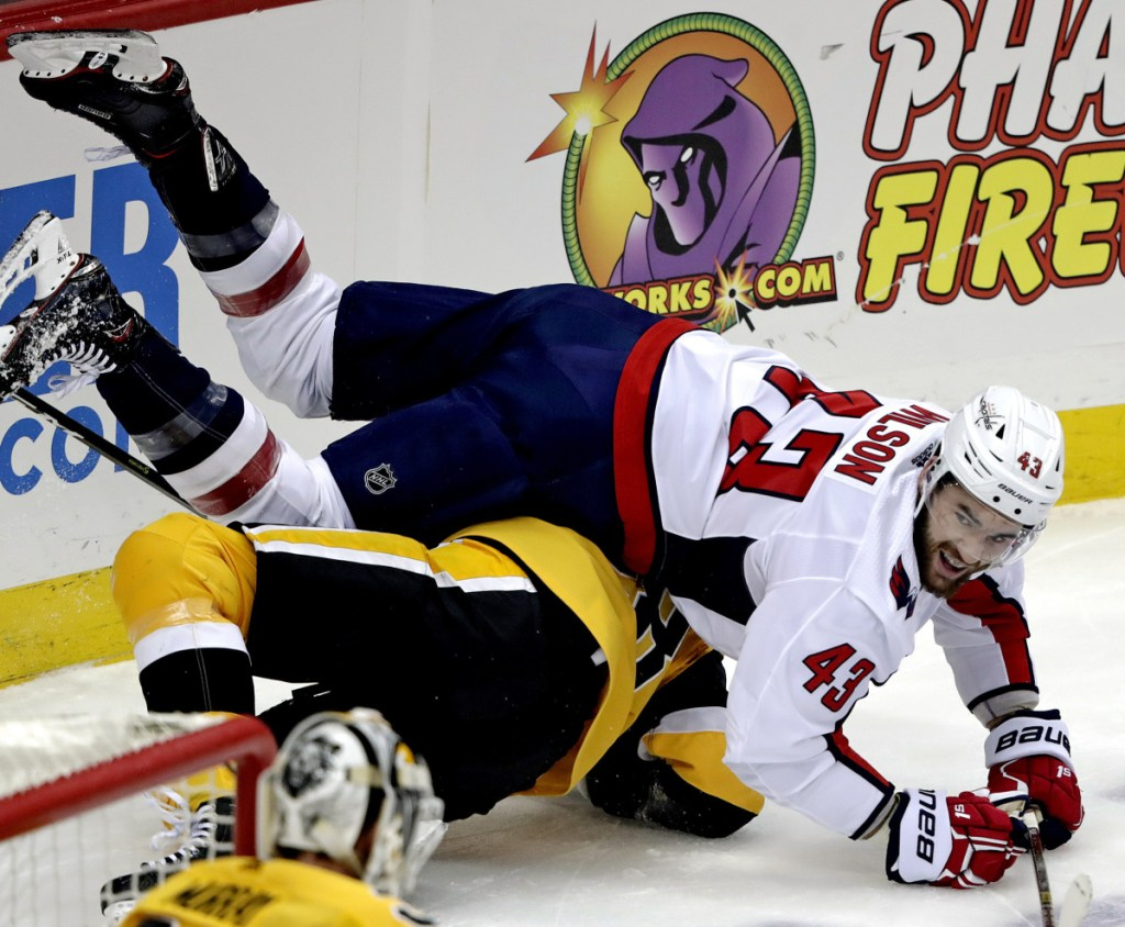 Tom Wilson of the Capitals collides with Pittsburgh's Marcus Pettersson in the first period Tuesday at Pittsburgh. The Penguins won 5-3, ending the Caps' seven-game winning streak.