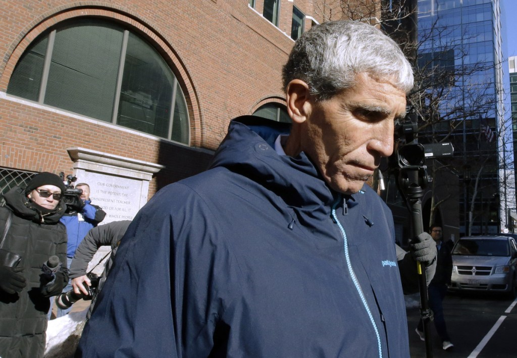 "William ""Rick"" Singer, founder of the Edge College & Career Network, leaves federal court in Boston on Tuesday after pleading guilty to charges in a nationwide college admissions bribery scandal."