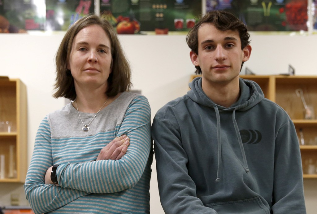 Matt Hogenauer, with Falmouth High School science teacher Amy Magnuson, says he contracted pertussis two weeks ago.