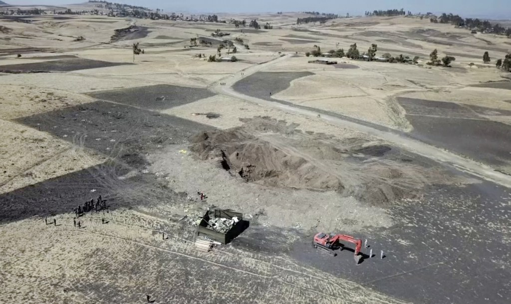 Aerial image shows recovery work continuing at the scene where the Ethiopian Airlines Boeing 737 Max 8 crashed shortly after takeoff last Sunday, killing all 157 on board, near Bishoftu, Ethiopia. Analysis of the flight recorders has begun in France, the airline said, while in Ethiopia officials started taking DNA samples from victims' family members to identify remains.