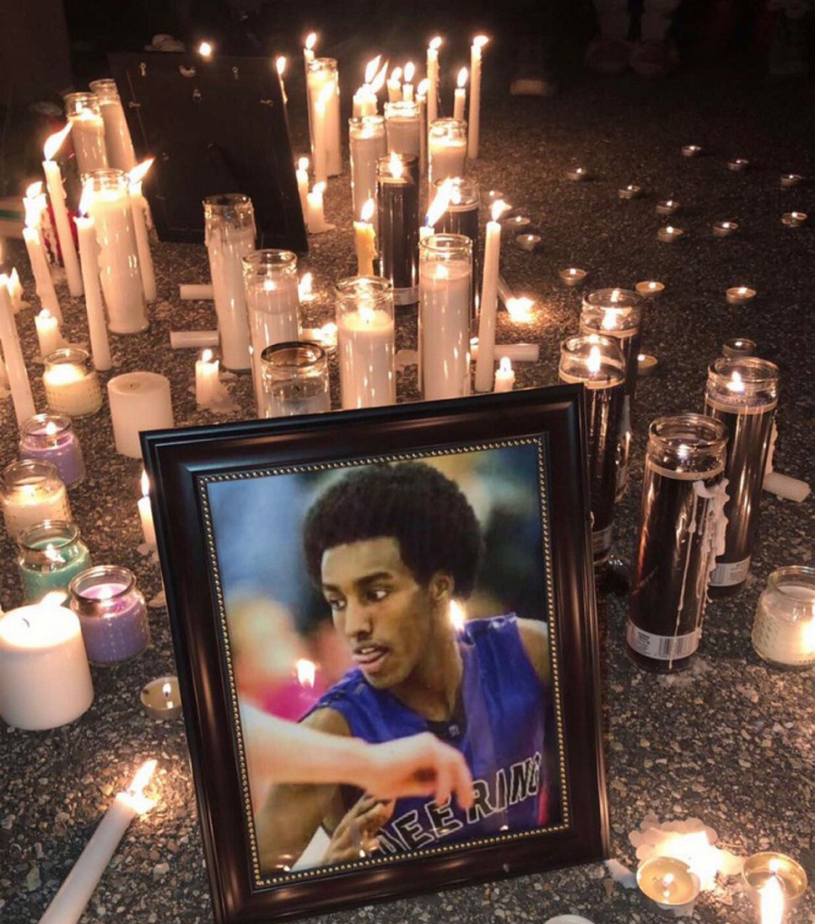 A vigil was held for Isahak Muse on Tuesday night at the Townhomes at Ocean East apartments in Portland. Muse was shot during an altercation at 1:45 a.m. at 107 Milton St. on Saturday and was dead when police arrived.