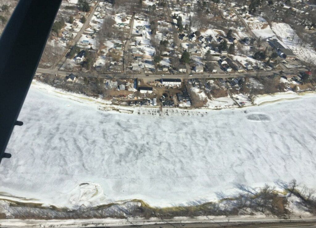 An aerial view of Worthing's Smelt Camps in Randolph, taken Wednesday, shows the frozen Kennebec River.