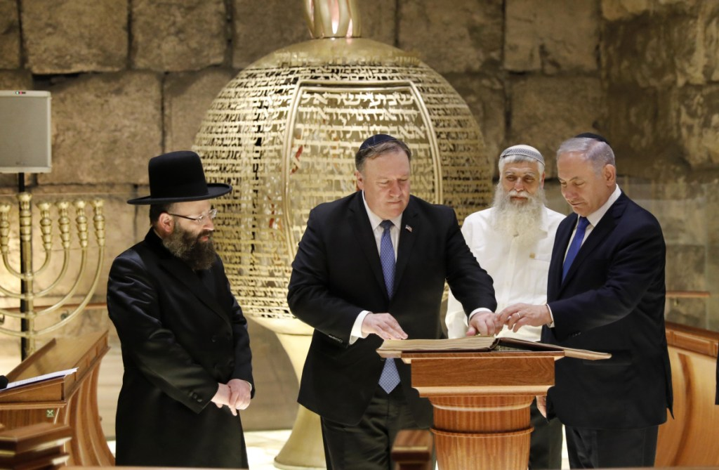 From left, Rabbi of the Western Wall Shmuel Rabinovitch, U.S Secretary of State Mike Pompeo, center, and Israeli Prime Minister Benjamin Netanyahu visit the Western Wall tunnels synagogue in Jerusalem's Old City on Thursday.