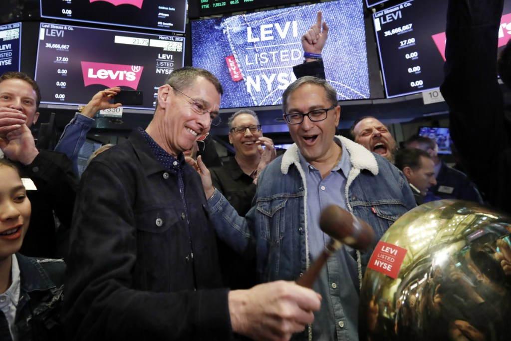 Levi Strauss CEO Chip Bergh, left, is joined by CFO Harmit Singh as he rings a ceremonial bell during his company's IPO Thursday on the floor of the New York Stock Exchange.