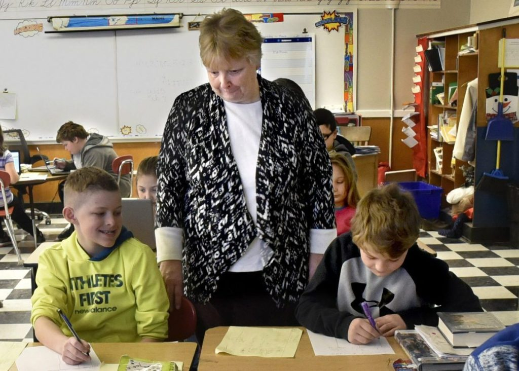 Quimby Middle School teacher Cathy Foran works with fourth-graders in Bingham. This month, residents in SAD 13 towns voted to close the school.