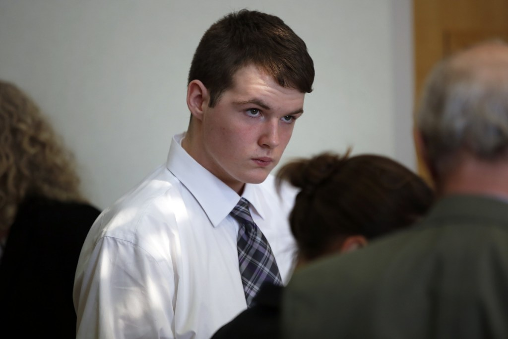 Dominic Sylvester confers with lawyers during a recess in his hearing on Thursday in West Bath District Court. The hearing will determine whether he will be tried as an adult. Sylvester was arrested and charged with murder in his grandmother's death when he was just 16 years old.